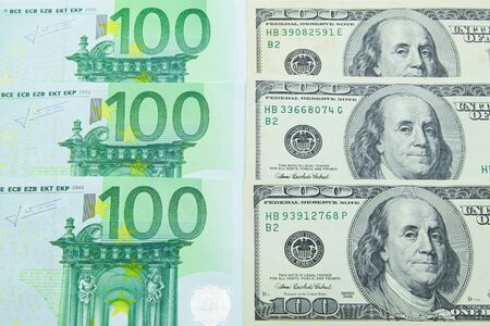 100 EUR and 100 USD banknotes background Archivio Fotografico