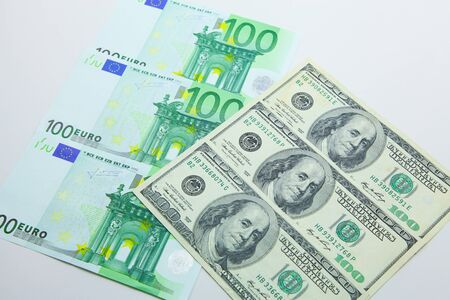 Isolated 100 EUR and 100 USD banknotes