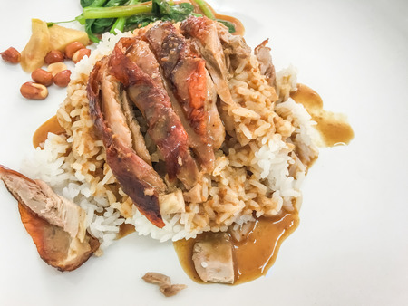 Roasted duck rice with vegetable, ginger and peanut in restaurant. top view. Stock Photo