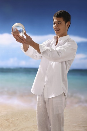 Man holding crystal ball