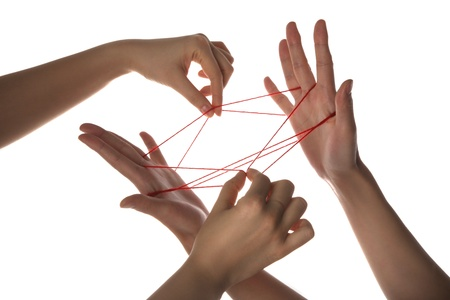People playing cats cradle game Stock Photo