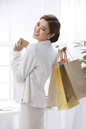 well dressed  holding: Businesswoman