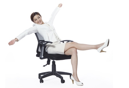 arms on chair: Businesswoman