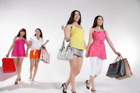 young women go shopping photo