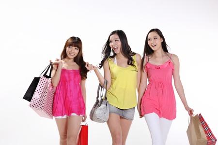 young women go shopping photo