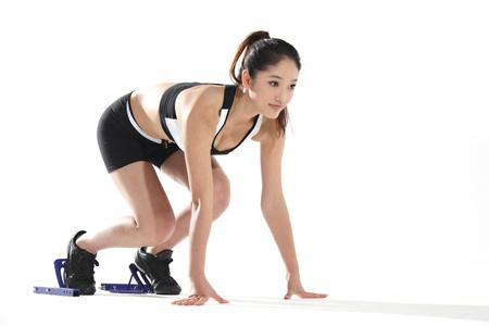 Young woman prepare to run