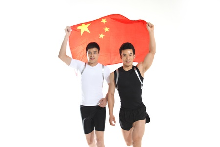 Young men holding up China flag,smiling  photo
