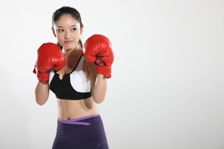 Young woman wearing boxing gloves Stock Photo - 16141862