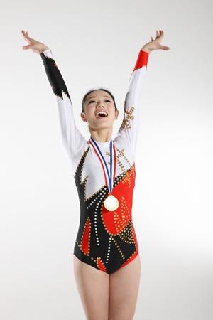 gymnastik: Porträtt av ung kvinna atlet
