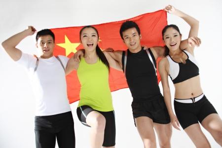 Group of young athletes holding China flag Stock Photo - 16141965