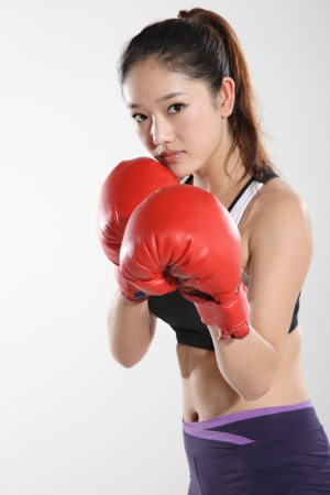 Young woman wearing boxing gloves  Stock Photo