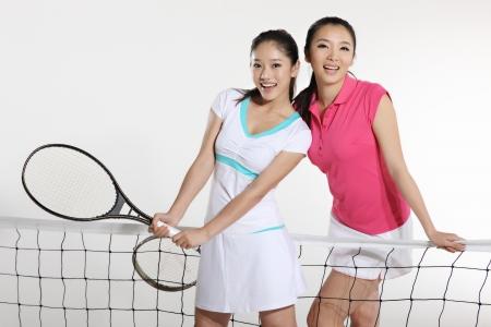 Young women playing tennis Stock Photo - 16142027