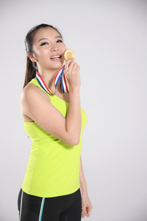 young athlete holding medal,portrait