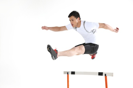 Man jumping hurdle  photo