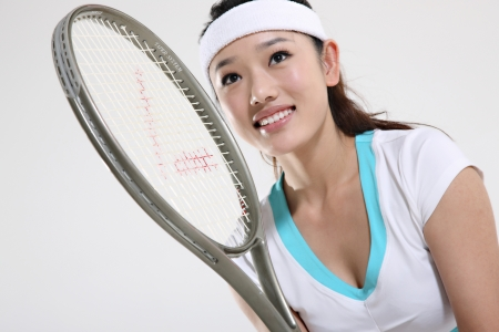 Young woman playing tennis Stock Photo - 16141955