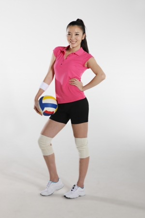 Young woman playing volleyball Stock Photo - 16141834