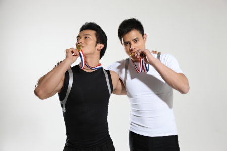 Two athletes wearing medals  photo