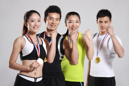 Group of young athletes wearing medals  photo