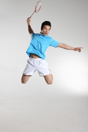 action sports: Young man playing badminton Stock Photo
