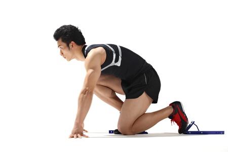 starting blocks: Male runner in starting blocks, close-up