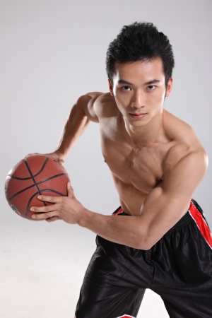 Young man playing basketball  photo