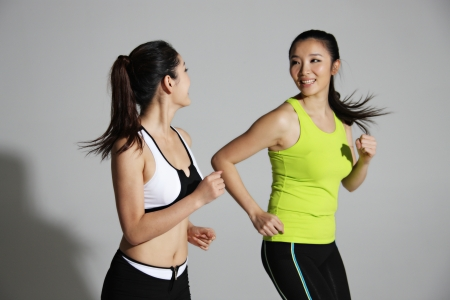 Two young women jogging