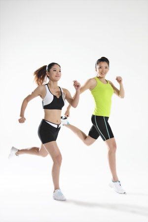 Two young women jogging  Stock Photo