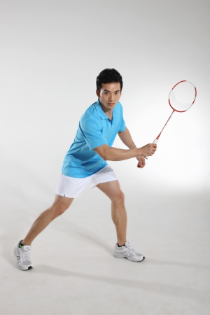 badminton racket: Young man playing badminton Stock Photo