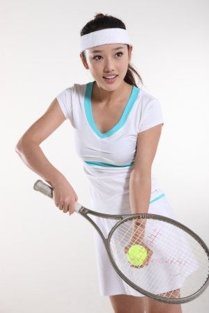 Young woman playing tennis Stock Photo - 16141921