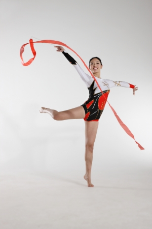 cut the competition: Young woman doing rhythmic gymnastics