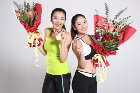 Group of young athletes holding medals and flowers Stock Photo - 16150943