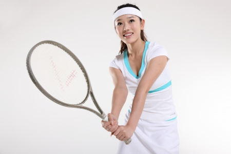 Young woman playing tennis Stock Photo - 16129803