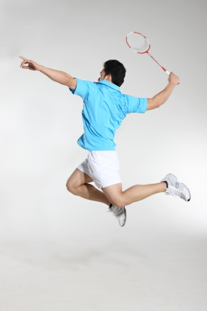 Young man playing badminton Stock Photo