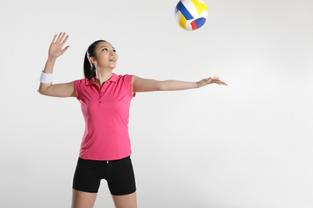 Young woman playing volleyball Stock Photo - 16129732