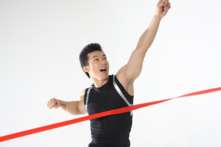 Young athlete with finish line photo