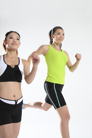 athleticism: Two young women jogging Stock Photo