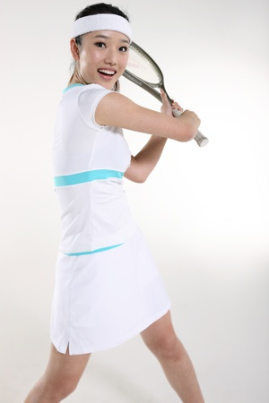 Young woman playing tennis Stock Photo - 16150935