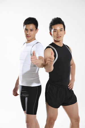 muscular men: Two athletes wearing medals