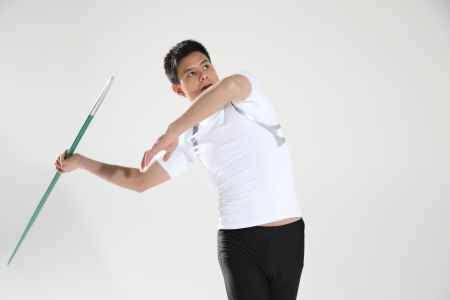 Male track athlete preparing to throw javelin