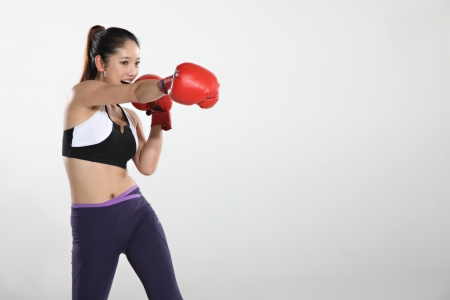Young woman wearing boxing gloves photo