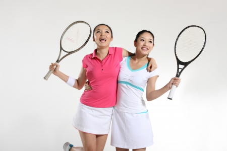 Young woman playing tennis Stock Photo - 16141452