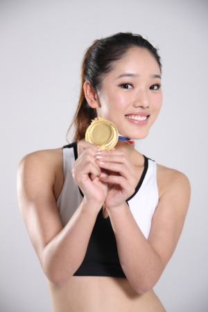 young athlete holding medal,portrait Stock Photo - 16209065