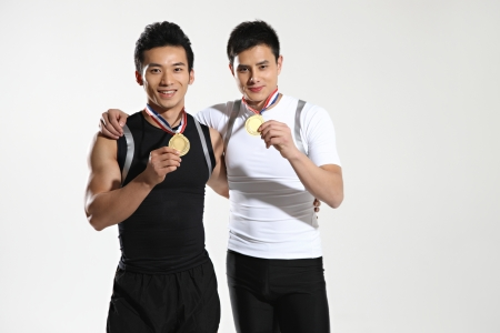 well build: Two athletes wearing medals
