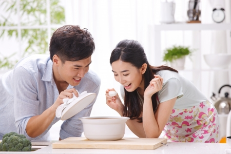 familial affection: Young couple in kitchen