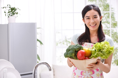 young woman in kitchen Stock Photo - 16190552