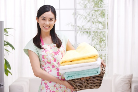 domestic chore: Young woman doing housework