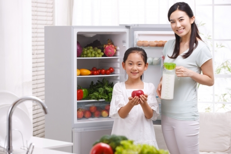 refrigerator: mother and daughter in kitchen