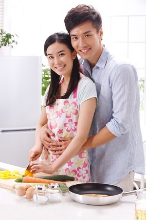 Young couple in kitchen Stock Photo - 16191156