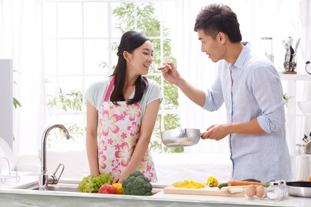 chore: Young couple in kitchen