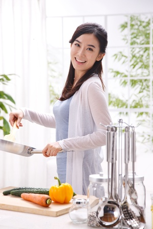 one young adult woman: young woman in kitchen